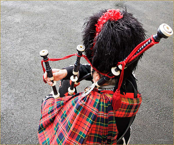 Piper on the bagpipes