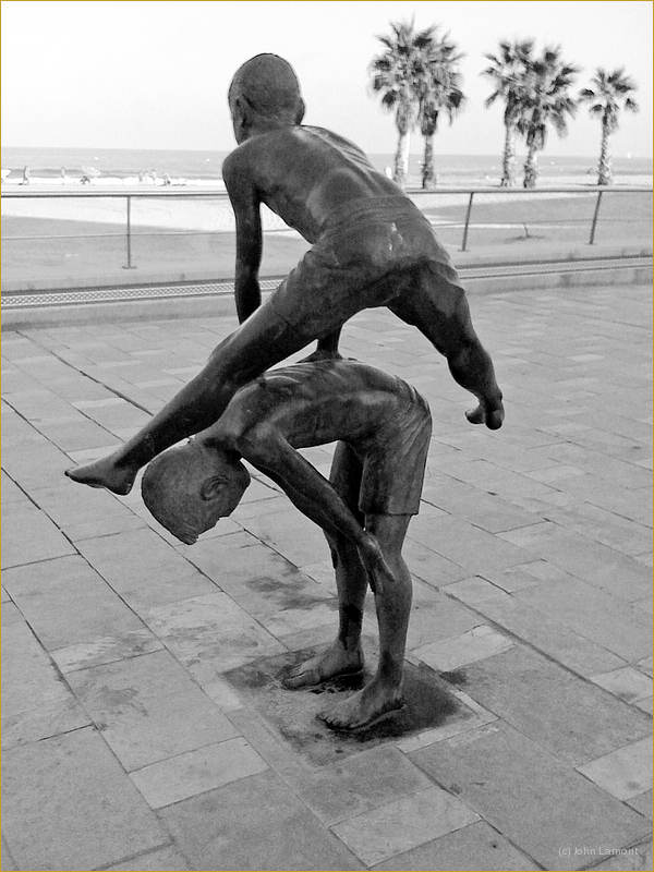 Sculpture of boys playing leapfrog