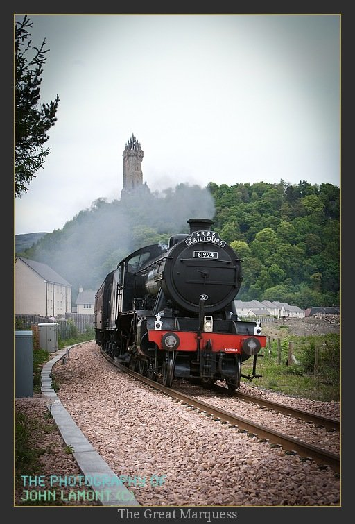 The Great Marquess steam engine 61994 in front of the Wallace Monument