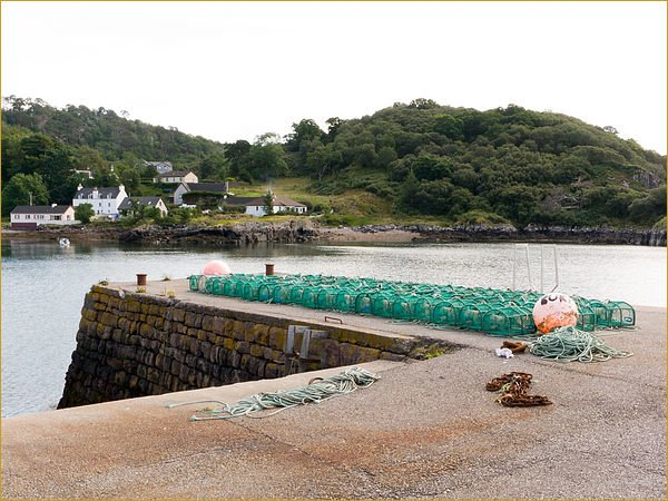 Lobster pots, ready on the harbour wall