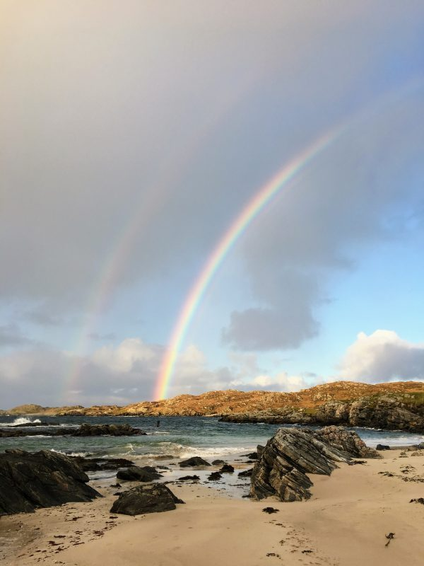Double rainbow over the beach, grabshot by phone